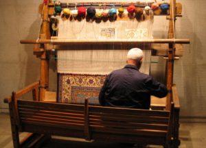 Man weaving a kilim rug