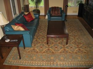 Place the rug on top of the padding