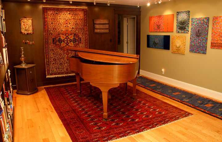 piano on top of bokhara persian rug