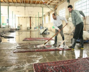 washing persian rug with water and soup