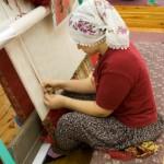 rug weaver weaving a Persian rug