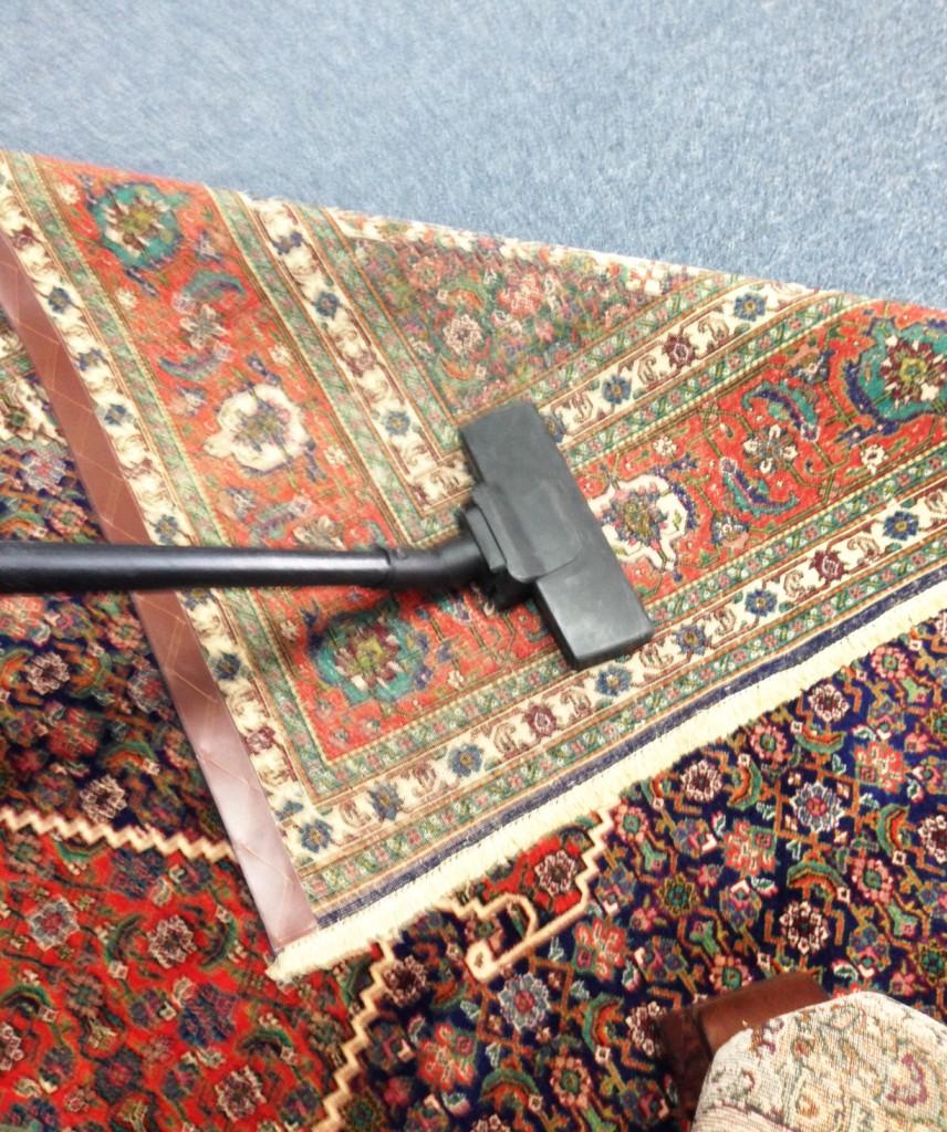 Vacuum its reverse side of rug