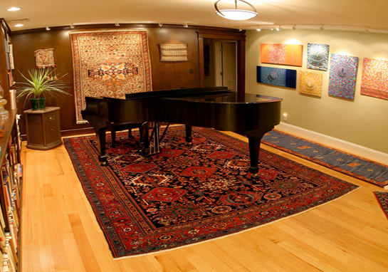 Antique Heriz rugs and piano on top