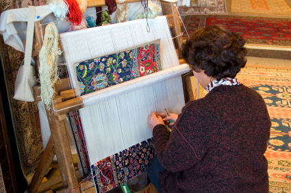 Persian Rug weaver working on the loom