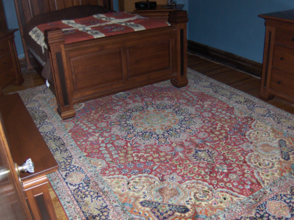 Bed Fits Partially On the Rug