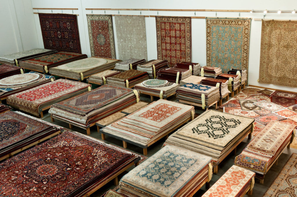 Piles of Persian Rugs and Oriental Rugs in Catalina Rug's Warehouse