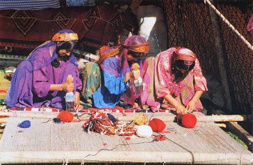 Qashqai Weavers Working Together On A Single Rug